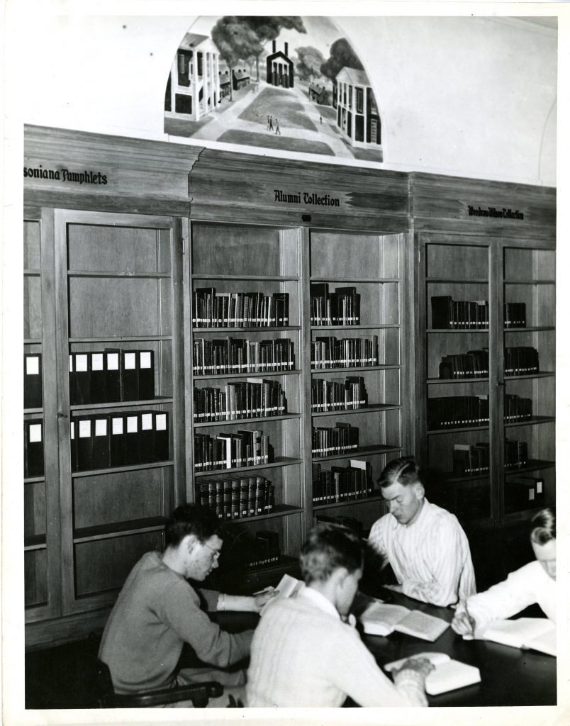 Students working at a table in the old Davidsoniana room in Grey Library, date unknown.