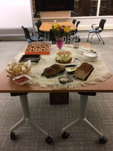 Research, Teaching, and Collection department's contributions to welcome Jessica Cottle. Table full of donuts, cake, bread, and paper plates