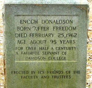 Headstone reading: ENOCH DONALDSON  BORN AFTER FREEDOM  DIED FEBRUARY 25, 1962  AGE ABOUT 95 YEARS  FOR JUST UNDER A CENTURY, SON, FATHER, HUSBAND,CHURCH FATHER & FRIEND   ROMANS 5:3-4  ERECTED IN HONOR OF A LIFE LIVED