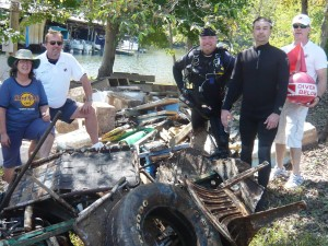 Five volunteers with debris from clean up day.